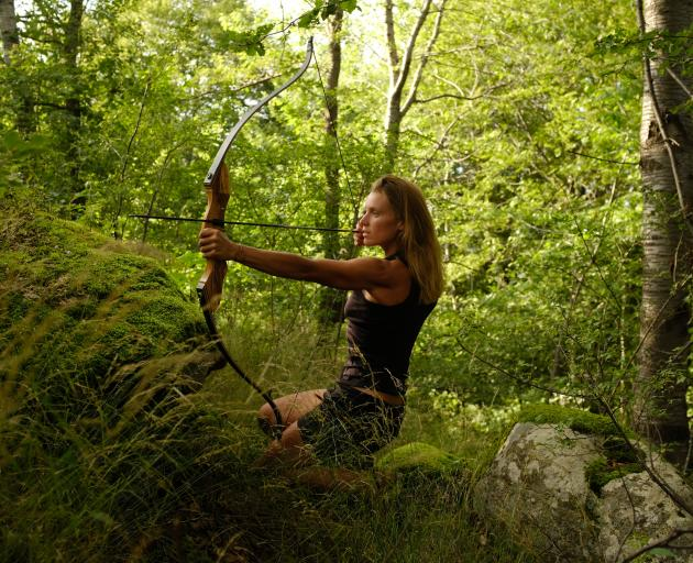 Miriam Lancewood practises hunting with her bow and arrows. Photos: Lindy Davis and Sofie Mulder