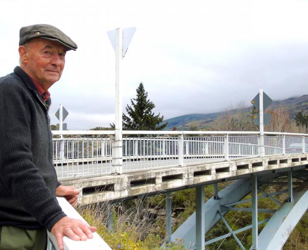 Teviot Valley resident John Rowley stands by the Jedburgh bridge across the Clutha River, at...
