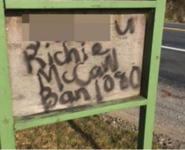 Defaced signs at Rangipo in the Central North Island abusing former All Black captain Richie...