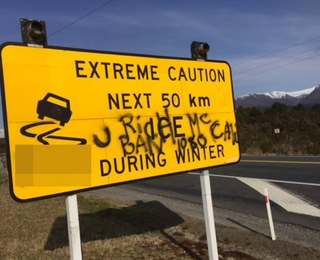 Another sign graffitied by 1080 activists on the Desert Rd SH1. Photo: Supplied