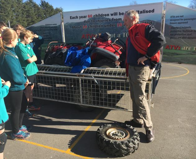 Waimakariri District Council rural safety co-ordinator Kerry Miles shows Sefton School pupils a quad bike which has been in an accident. Photo: David Hill