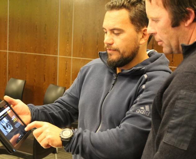 Shane Ratima (left), of the New Zealand Shearing Contractors Association, shows farmer Stuart...