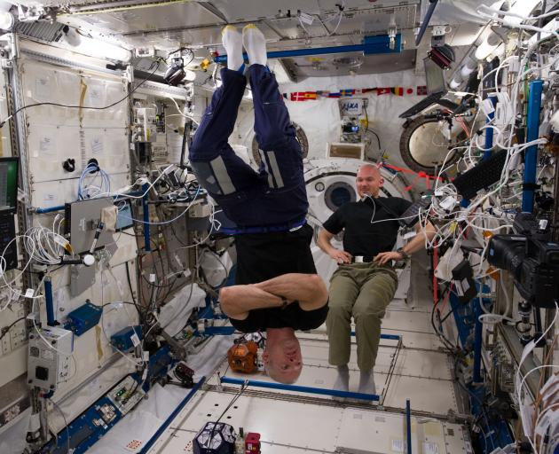 Astronauts in the International Space Station wear T-shirts made from merino wool by Armadillo Merino during an expedition in 2014. Central Otago farmers supply merino wool to New Zealand Merino, which sells it to companies such as Armadillo. Photo: NASA