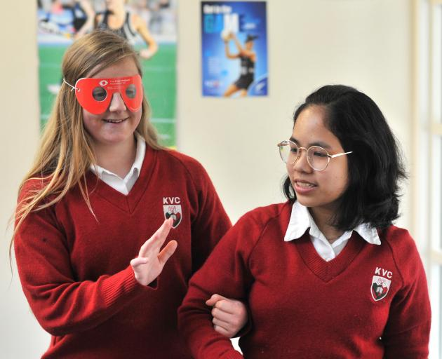 Kaikorai Valley College year 10 pupil Emma Hedges needs a guiding hand from fellow pupil Katha Isip as she tries to find her way while experiencing the effects of cataracts through cataract simulation goggles. Photo: Christine O'Connor
