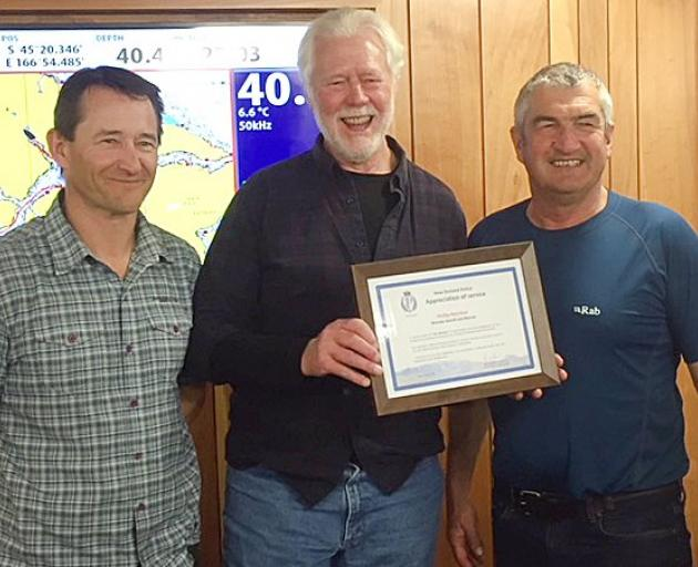 Wanaka Search and Rescue stalwart Phil Melchior (centre) receiving a life membership of the...