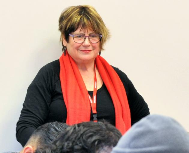 Creative writing tutor Diane Brown instructs prisoners at her New Chapters workshop. Photos:...