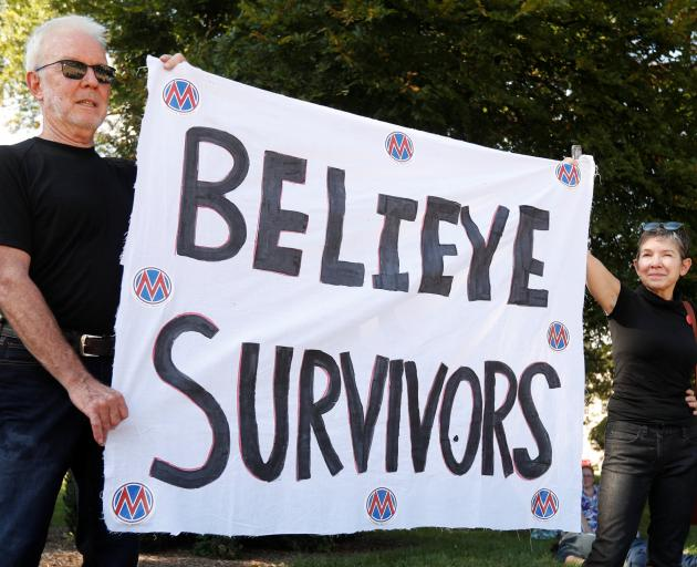 Activists hold a protest and rally in support of Christine Blasey Ford, the university professor who accused Kavanaugh of sexual assault in 1982. Photo: Reuters