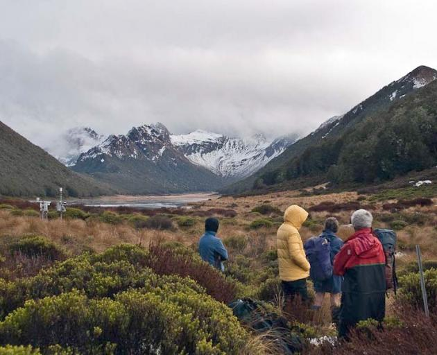 Members of the Fiordland Tramping and Outdoor Recreation Club at the Takahe Valley with Lake...