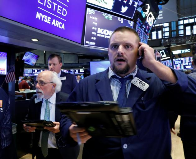 Traders on the floor of the New York Stock Exchange in Manhattan, New York, watch on Wednesday as...