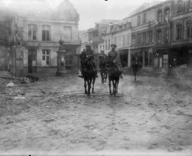 New Zealand Division commanders enter Le Quesnoy the day after its capture.