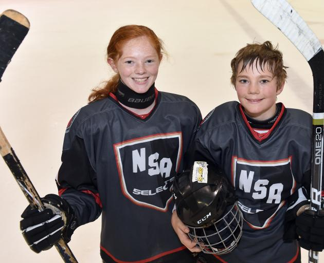 Australian duo Ariel (13) and Hugh (12) Campbell are part of the NSA Select team at the international pee-wee ice hockey tournament at the Dunedin Ice Stadium where both learned to skate. Photo: Peter McIntosh