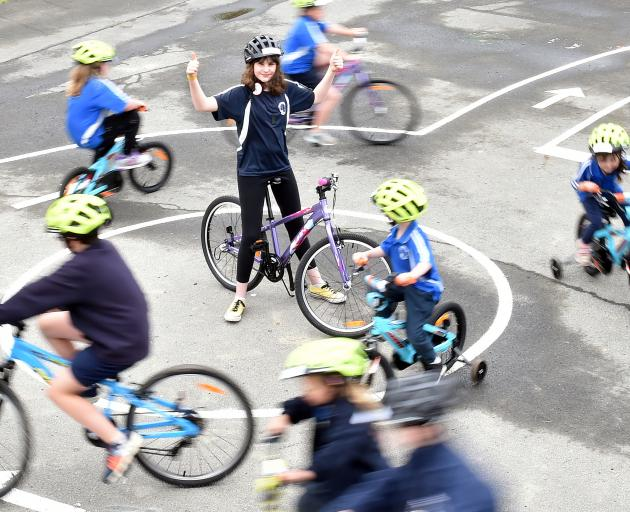 Carisbrook School pupil Ramona Mahutte (13) celebrates the opening of a new bike tracks at the...