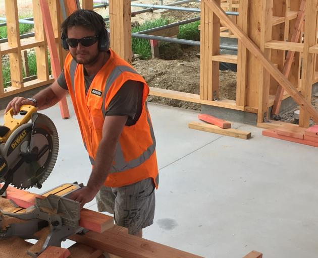 Brett McEwan (34) is one of many adults completing an apprenticeship with Breen Construction. Photo: Alexia Johnston