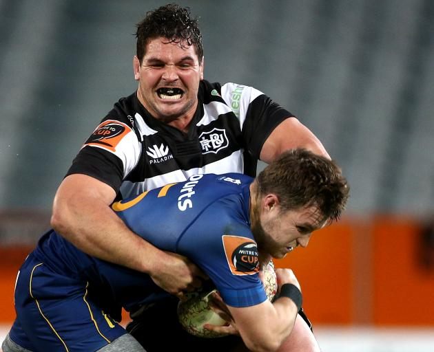 Michael Collins of Otago is tackled by big Ben May from Hawke's Bay during the first half at...