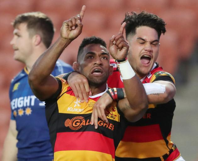 Waikato's Sevu Reece (centre) celebrates his try with team-mate Quinn Tupaea. Photo: Getty Images