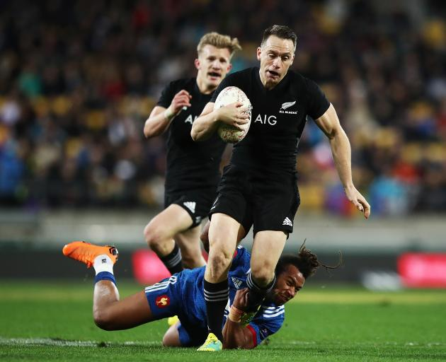 Ben Smith breaks the tackle of a French player earlier this year. Photo: Getty Images