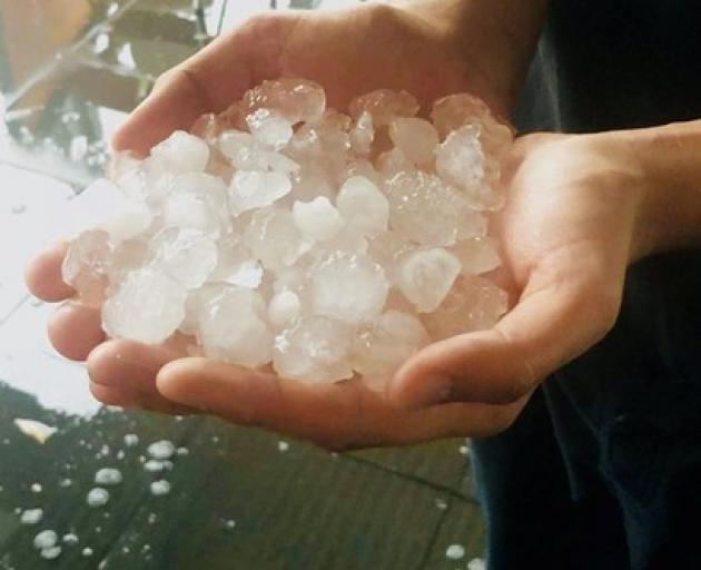 A person holds hailstones during a hailstorm in Gympie, Queensland, Australia October 11, 2018 in this picture obtained from social media. @ambrosiaindiangympie/via REUTERS