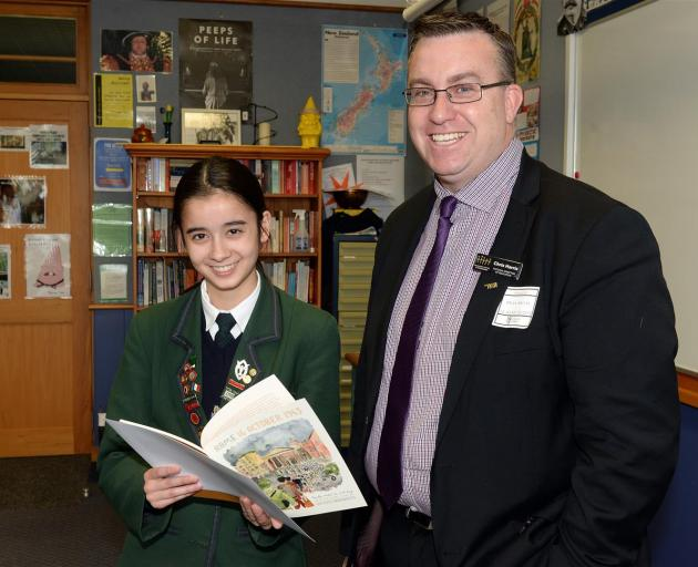 Columba College pupil Georgia Wong receives a prize from New Zealand Holocaust Centre director Chris Harris after winning the Paul Seideman Annual Composition Prize. Photo: Linda Robertson