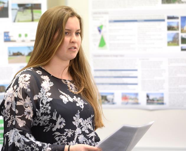 Surveying student Jess Smyth delivers her semester's work on plans for a development to deal with...