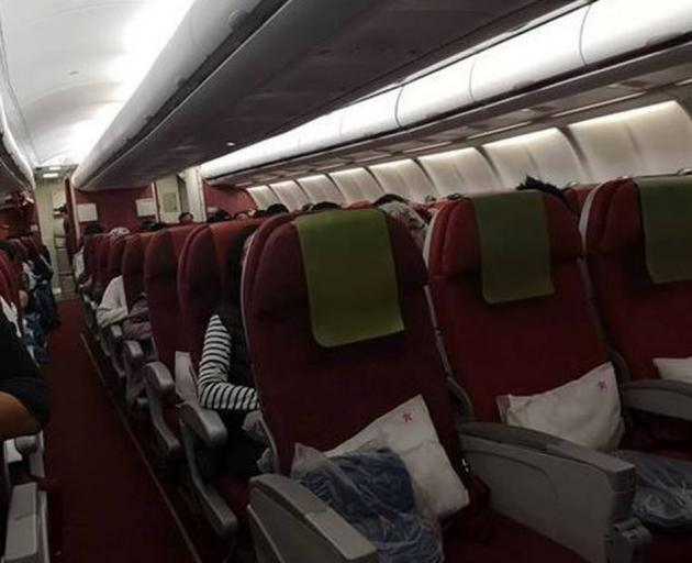 The row of four empty seats on a Hong Kong Airlines flight that a passenger had to pay $100 to...