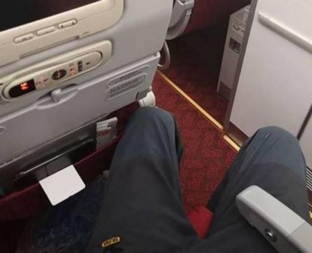 Richard Mountain's legs were too long for the aisle seat he was given on a Hong Kong Airlines...