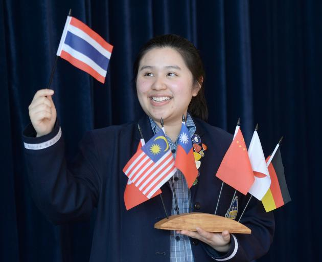 Otago Girls' High School international prefect Pear Sae-Lee waves the flag of her home country, Thailand. Photo: linda Robertson