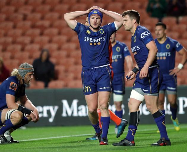 Otago's James Lentjes (centre) looks dejected during the Mitre 10 Cup Championship Final against...