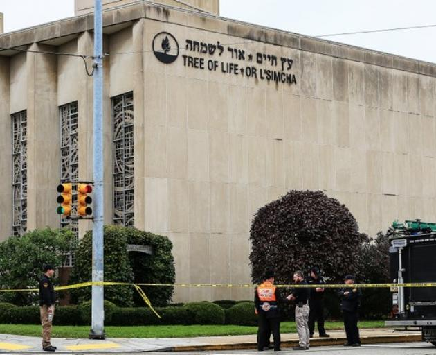 Police officers guard the Tree of Life synagogue following shooting at the synagogue in Pittsburgh. Photo: Reuters
