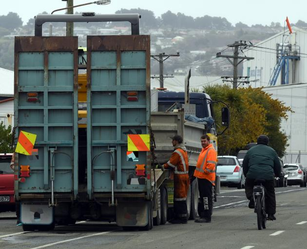 A cyclist rides around a truck parked across a cycleway in Dunedin yesterday. PHOTO: STEPHEN...