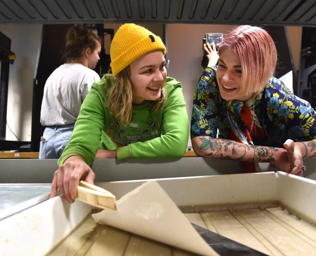 Rachel Allan (right) talks to  first-year photography student Imogen Salvage (21) in the dark room at the Otago Polytechnic Art School. Photos: Peter McIntosh