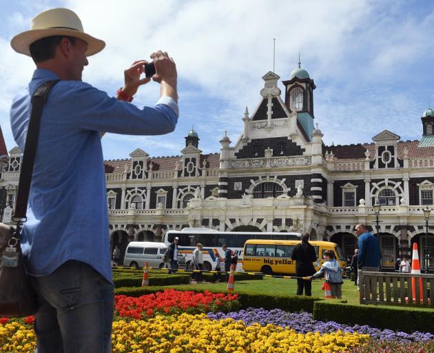Raymond Van Der Heiden, of Holland, photographs the Dunedin Railway Station yesterday. Plans for...