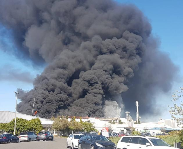 Firefighters are trying to extinguish a blaze after a fire broke out at the Ravensdown fertiliser facility in Christchurch today. Photo: Star.kiwi