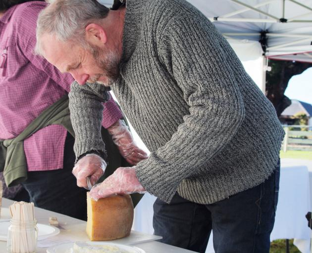 Cheesemonger Martin Aspinwall, of Canterbury Cheesemongers, cuts cheese at last year's amateur cheesemakers' competition. Photo: Supplied