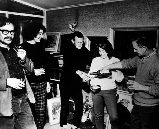 Shadbolt (left) with (from second left) artist Lois McIvor, painter Colin McCahon and party hosts...
