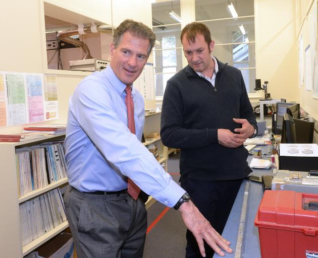 United States ambassador Scott Brown (left) discusses an Antarctic core sediment sample with University of Otago Geology Department research scientist Dr Christian Ohneiser. Photo: Linda Robertson