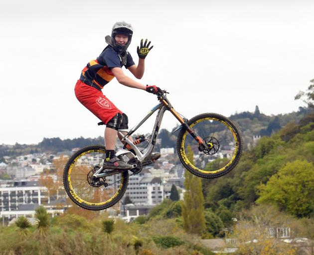Zach White waves as he makes a jump at the bottom of the Signal Hill track yesterday. PHOTO...