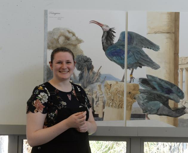 Elaine Mitchell (20) with one of her natural history-inspired works, Palmyrene, depicting the endangered Northern Bald Ibis in Syria. Photo: Linda Robertson