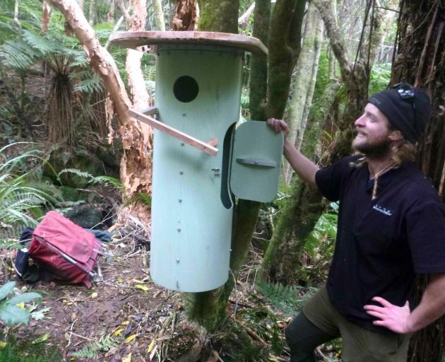 A luxury home: Geoff Clark displays one of the new nesting boxes he has built and installed for...