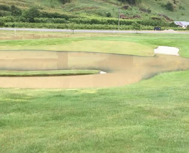 Roxburgh golf course had significant flooding. 3: A Roxburgh orchard yesterday morning.