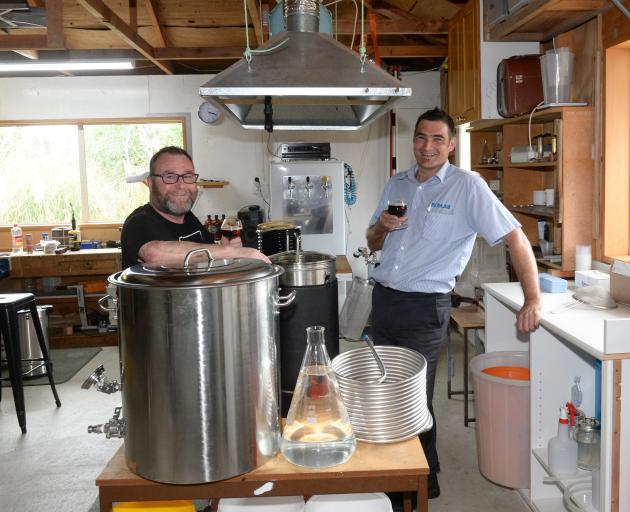 Mosgiel brewers Brett Houliston and Jimmy Henderson raise their prize-winning brew. PHOTO: LINDA...