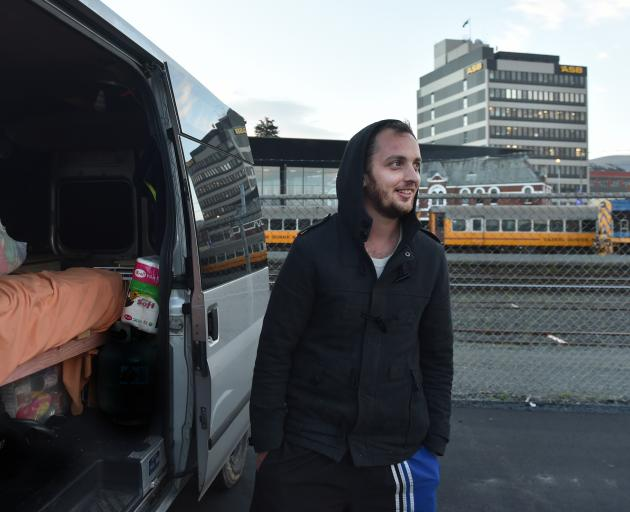 Freedom camper Sam Cootes, with his new home on wheels, at the Thomas Burns St freedom camping site, in Dunedin last night. Photo: Peter McIntosh