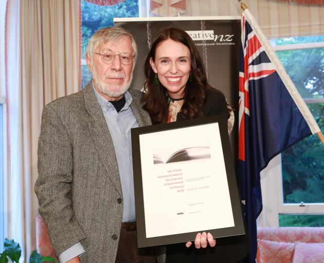 Alexandra poet Michael Harlow is congratulated by Prime Minister Jacinda Ardern on receiving the Prime Minister's Award for Literary Achievement in Poetry. Photo: Supplied