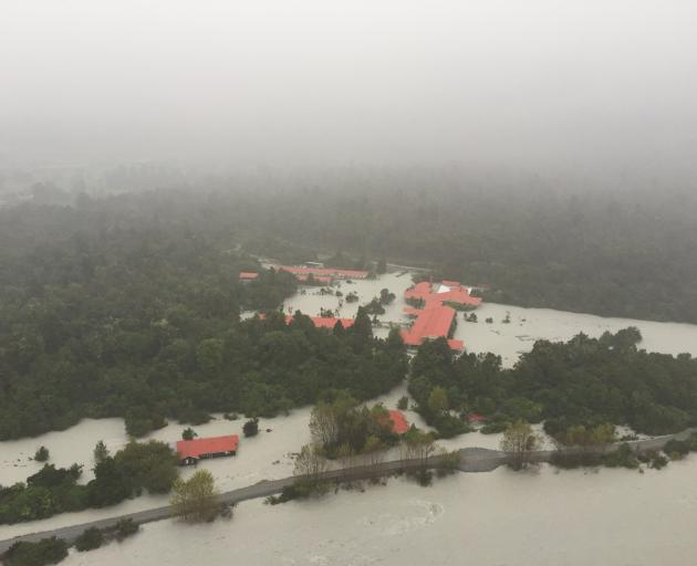 The flooded Waiho River rages through the Scenic Hotel at Franz Josef Glacier in March 2016. Photo: Greymouth Star