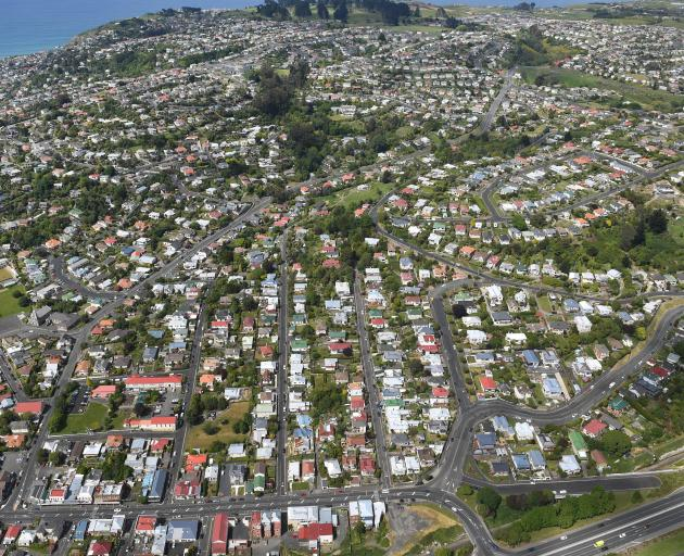 Like much of Otago, Dunedin sales in October rose more than 10% to 215 homes, while the city's median price rose 15.1% to a record $430,500; pictured is the suburb of Caversham, and Corstorphine beyond. Photo: Stephen Jaquiery