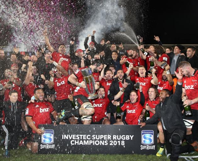 The Crusaders celebrate after winning their ninth Super Rugby title in this year's final against...