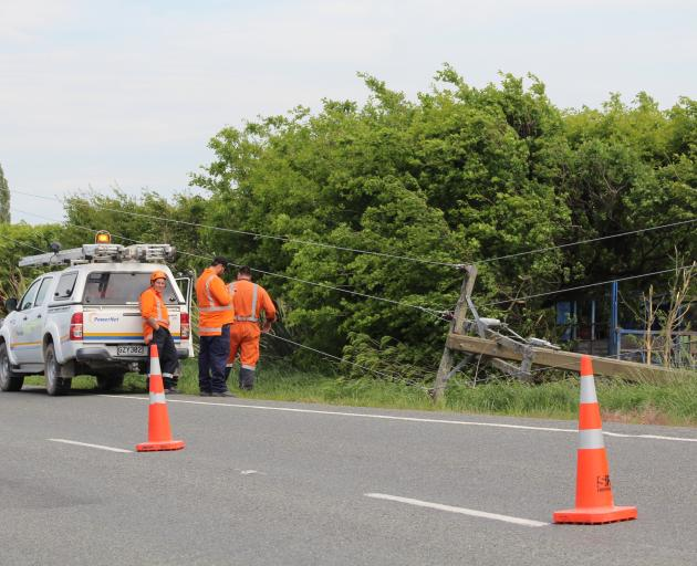 Crews respond to damaged power lines after a single-vehicle accident on the Dipton-Winton Highway yesterday. Photo: Ben Waterworth
