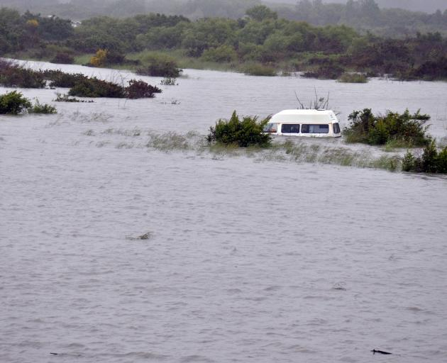 A whitebaiter's abandoned van was flooded on an island in the middle of the Hokitika River...