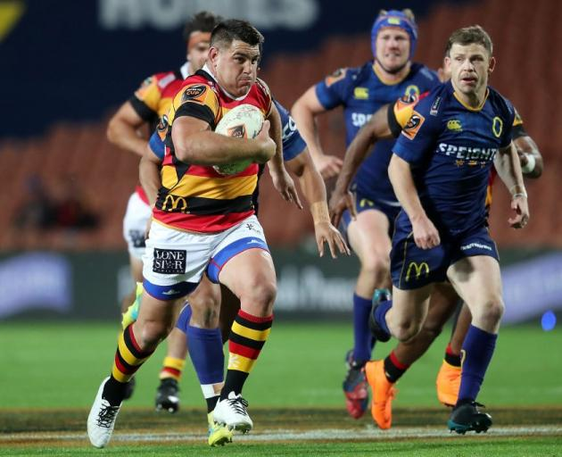 Waikato's Dwayne Sweeney makes a break as Otago's Kurt Hammer (right) chases after him during the...