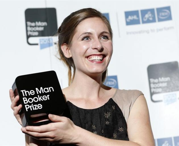 Eleanor Catton holds up the Man Booker Prize she received for her novel The Luminaries last year....