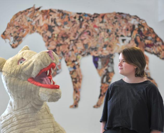 Emily Davidson will hang her female werewolf head like a trophy head in the exhibition. Her original photo collage work is in the background. Photo: Christine O'Connor